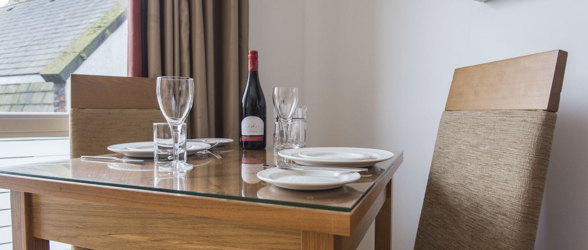 Dining table at PREMIER SUITES Liverpool serviced apartment