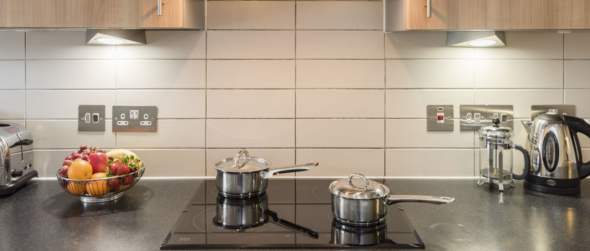 PREMIER SUITES Liverpool modern cooking hob in the serviced apartments